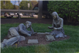 Man and Woman Reading Statue in Front of Library